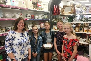 The E Girls, Holly Slater, Isabella Skelton-Edmunds, Sadie Maling and Amelia-Rose Thomas with Donna Hall at the Cancer Research UK charity shop in Rustington