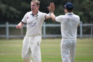 John Morgan celebrates a wicket for division 2 leaders Hastings. Picture by Justin Lycett
