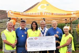 Littlehampton Rotary Club presents the cheque to Chestnut Tree House children's hospice, from left, hospice volunteer Greg Hopkins, Rotarian Keith Green, community fundraiser Caroline Roberts-Quigley, Rotarians John Mitchell and Geoff Watts, and volunteer Pamela Cork