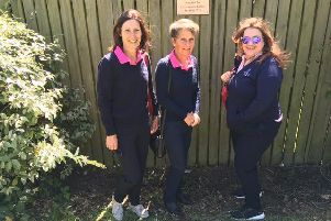 Jill Lewis, Heather Skinner and Margaret Brice beside the garden nameplate donated by SL2 Designs
