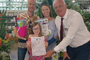 Enva with her parents receiving first prize from Paul Smythe