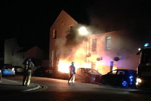 A car burst into flames in a Worthing street last night