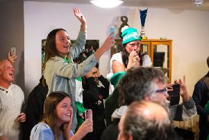 Relatives of the players and management show their joy at Chi's bye into the next round / Picture: Daniel Harker