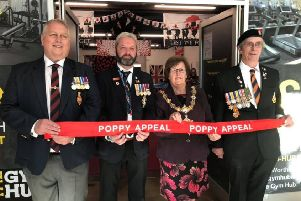 The official opening of the Poppy Appeal shop in Worthing, with, from left, Worthing Veterans Association chairman Steve Hinton, Worthing Poppy Appeal organiser Barry Cook, Worthing mayor Hazel Thorpe and Royal British Legion volunteer Ian Newman