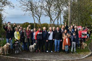 MP Nick Herbert celebrating with campaigners at the entrance to the field which has been saved from development. Developers wanted to build 42 homes off Sandy Lane in Henfield (photo by Julie Mitchell).
