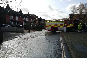 Station Road in Horsham is under a foot of water