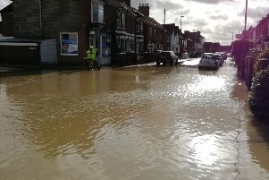 Station Road in Horsham was under a foot of water