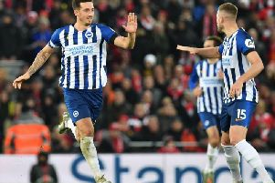 Brighton and Hove Albion's Lewis Dunk makes it 2-1 at Liverpool after his clever