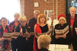 The Phoenix Singers opened and closed the club's Rememebrance service