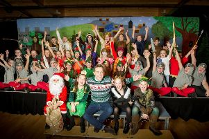 Stephen Mulhern with last year's winners Carlisle's Pennine Way primary school with their play 'Robin Hood Saves Santa'. SUS-190312-114226001