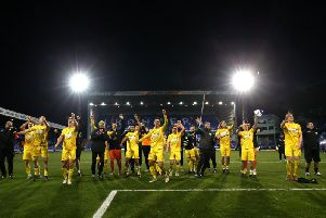 The players take the plaudits from the Chi City fans after the final whistle at Prenton Park / Picture by Getty Images