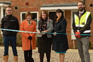 Horsham district councillor Tricia Youtan cuts the ribbon at the official opening of new homes near Horsham's Holbrook Club SUS-190512-150520001