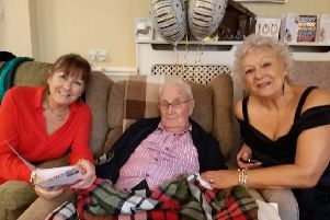 Christmas Godfrey Evans with his daughters on his 100th birthday SUS-200601-142659001