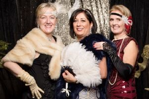 Helen Johnson, Sharon Davis and Louise Constable from West Chiltington during the 1920s-themed New Year's eve party they organised. Picture: Paul Streeter-Staniford Photography