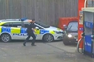 A police car was rammed at a Copthorne garage  SUS-200115-162543001