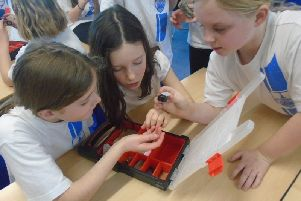 Children at St Lawrence Primay School, Hurstpierpoint,, with some lunar rocks SUS-200123-155748001