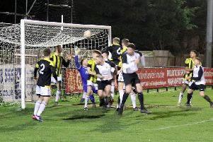 Pagham are about to take the lead against Loxwood / Picture: Roger Smith