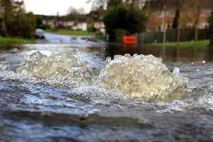 Flooding at the junction of Westlands Road and America Lane in Haywards Heath. Picture: Steve Robards