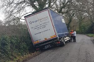 The lorry in the ditch. Photo by Horsham Police