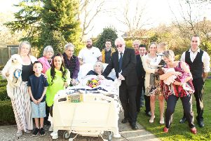 Sally and John Paice with their family at their vows renewal ceremony in 2018 in the garden of St Wilfrid's Hospice's former site in Grosvenor Road