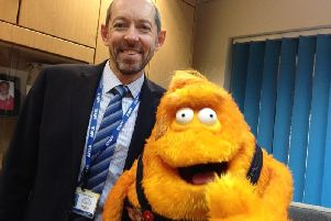 Ian Holmes, headteacher at Holbrook Primary School, with CBBC's Saturday Mash-Up presenter Stanley the puppet SUS-200203-133905001
