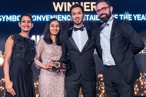 Amish Shingadia (second from right) is presented with the Symbol Convenience Retailer of the Year award by Ross Hennessy of sponsors JTI (right) and BBC presenter Naga Munchetty (left) SUS-200203-163842001