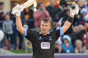 Chris Nash celebrates a century for Sussex. Picture by PW Sporting Photography