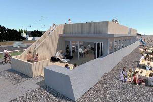 An artist's impression of plans for the Littlehampton seafront shelter, which could become a cafe and kitesurfing school SUS-171121-142745001