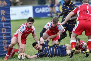 Matt McLean touches down one of his three tries. Picture by Stephen Goodger