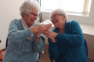 Jean Atkinson, left, and Patricia Naisbit enjoying laughter yoga at Chesham House