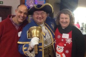 The Rev Sara Jane Stevens and her husband Bob Stevens with Worthing town crier Bob Smytherman