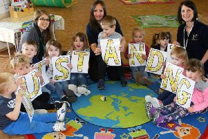 Staff and children at Little Rascals celebrate their outstanding Ofsted report