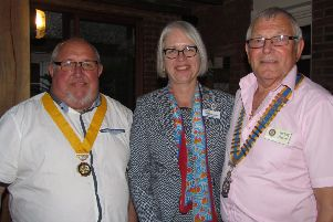 President David Cook (left) with Rotary assistant district governor Annemarie Allen and retiring president Jeremy Flaskett