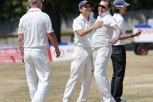 Keir McCarthy celebrates one of his three wickets for Broadwater. Picture by Stephen Goodger