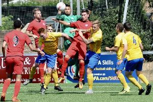 Action from Lancing's friendly clash with Sutton Common Rovers
