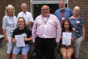 Students Lucy Godden and Courtney Charman with David Cook, president of West Worthing Rotary Club, and Rotarians Trish Sullivan, Charles Pressley, the head of centre Mark Andrews and Rotarian Sue Virgo