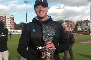Ollie Robinson with the trophy after being named Sussex's county championship man of the season