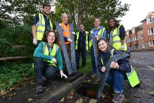 Council staff and councillors installing the special 'ladders' in drains