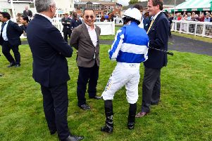Vichai Srivaddhanaprabha with connections including trainer Richard Hannon and jockey Ryan Moore at Salisbury racecourse last month / Picture Malcolm Wells / Picture Exclusive.com