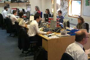 Our trained journalists hard at work in the Herald's newsroom