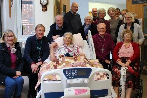 Bishop Mark Sowerby with patients, families, staff and volunteers at St Barnabas House in Worthing SUS-190115-110852001