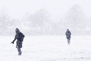 Two figures silhouetted against a snowy backdrop, with the trees the other side of Broadwater Green barely visible