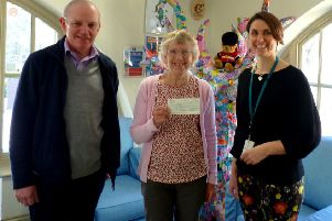 Tricia Hall and David Bettiss presenting the cheque to Chestnut Tree House