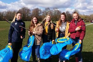Millie Patel, Anna Owen, Olivia Heap, Maisie Ridpath and Ella Dallimore picking litter to raise money for their Ghana trip