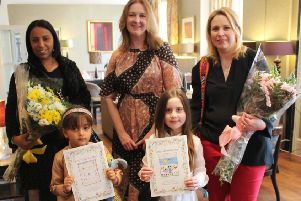 Fiona Murden presents flowers to Nazha Maizi, with daughter Lailah, and Sarah Marchant, with daughter Ayla