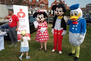 Donald Duck, Minnie Mouse and Mickey Mouse were handing out competition forms for the Easter egg hunt at Broadwater Easter Fayre