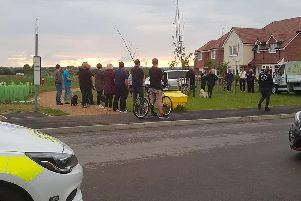 Residents and police on the Kingley Gate estate. Pic: Amber Banson