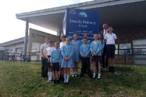 Headteacher Lee Murley with Year 6 prefects and pupils of Seaside Primary School SUS-190522-103744001