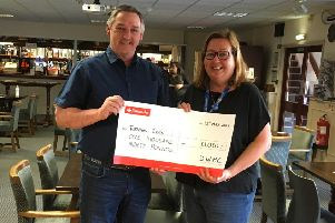 Peter Stickley presenting the cheque to Sue Stevens from Turning Tides`