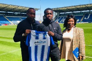 Kwame Poku (centre) left Worthing to sign a professional contract at Colchester United earlier this month